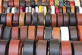 Leather belts set of different and colorful as a background Stock Images