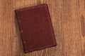 Leather book on wooden board Royalty Free Stock Photo