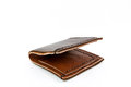 Leather brown wallet handmade isolated on white background Royalty Free Stock Photo
