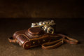 Leather cover and old 35mm camera Royalty Free Stock Photo