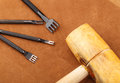 Leather craft tool with hammer Royalty Free Stock Images