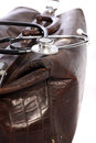Leather doctors bag and stethoscope closeup of a brown with shallow dof on a white background Stock Images