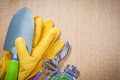 Leather gloves hand shovel sharp garden pruner soft tie on woode Royalty Free Stock Photo