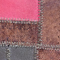 Leather patchwork brown close up background Royalty Free Stock Photo
