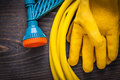 Leather safety gloves and hand spraying hose with Royalty Free Stock Photo