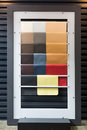 Leather samples of different colors at car dealership showroom Stock Photo