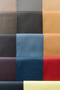 Leather samples of different colors at car dealership showroom Royalty Free Stock Photography