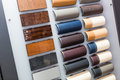 Leather samples of different colors at car dealership showroom Royalty Free Stock Photos