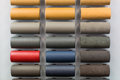Leather samples of different colors at car dealership showroom Royalty Free Stock Images