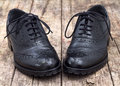 Leather shoe with shoelace on wooden background Stock Photos