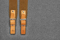 Leather strap with a buckle on gray background Royalty Free Stock Photography