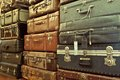 Leather suitcases stacked vintage old battered Stock Images