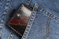 Leather wallet in a pocket decorated of blue jeans Royalty Free Stock Images