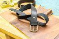 Leather workshop belt in front of grips on table black with tools Royalty Free Stock Image