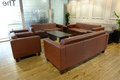 Leathers sofas and coffee table modern room with brown around a Stock Images