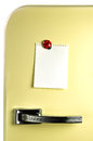 Leave a message on the fridge blank note fifties door copyspace for Stock Photos