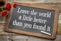 Leave the world a little better on blackboard than you found it life purpose and meaning concept white chalk text vintage with Stock Image