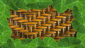 Leaves with hand made wickerwork from rattan for backgroun green background Royalty Free Stock Photography