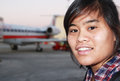 Leaving on a jetplane teenage filipino or asian female s headshot by commercial commuter plane the background Stock Photo