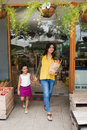 Leaving supermarket indian family after grocery shopping Stock Image