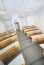 Lecture room ascending with tables arranged in rows taken in unusual perspective Stock Photos