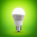 Led bulb glowing on green background Royalty Free Stock Photography