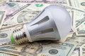 LED electric bulb on dollar Royalty Free Stock Photo