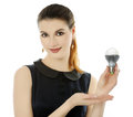 Led lamp cheerful girl holding Stock Image