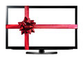 LED or LCD TV with red christmas gift ribbon Royalty Free Stock Photo