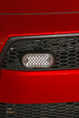 Led lights at red car grille Royalty Free Stock Photography