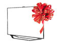 Led television with ribbon against white background Royalty Free Stock Photography