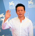 Lee kang sheng poses for photographers at th venice film festival on september in venice italy Stock Images