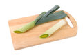 Leek on the cutting board isolated on the white Royalty Free Stock Photo