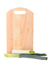 Leek and the cutting board isolated on the white Royalty Free Stock Photo