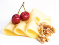 Leerdammer cheese slices with nuts and cherries on white base Stock Photography