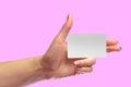 Left Female Hand Hold Blank White Card Mock-up. SIM Cellular Royalty Free Stock Photo