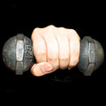 Left hand and dumbbell on black background Royalty Free Stock Photography