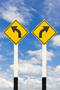 Left and right curved road signpost Stock Photography