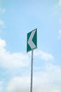 Left turn road sign with blue sky Stock Photography