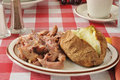 Leftover turkey a plate of with a baked potato and butter Stock Images