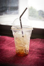 Leftovers ice coffee in plastic cup with dark vignette Stock Photos