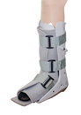 Leg with an ankle brace woman over white Royalty Free Stock Photo