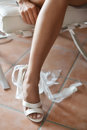 Leg of bride in white shoes Royalty Free Stock Photo