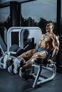 Leg Exercises - Man Doing Leg With Machine In Gym Royalty Free Stock Photo