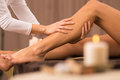 Leg massage at spa salon woman getting treatment on legs Stock Photo