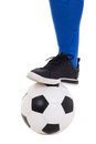 Leg of soccer player in blue gaiter with ball isolated on white one background Stock Photos