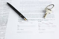 Legal document for sale of real estate, with fountain pen and house keys Royalty Free Stock Photo