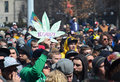 Legalize sign at ann arbor hash bash mi april a participant holds up a the rd annual rally in mi april Royalty Free Stock Photos