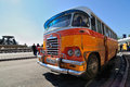 Legendary and iconic malta public buses the in the valletta city bus station in april Royalty Free Stock Photo