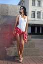 Leggy beautiful lady standing on sidewalk of city Royalty Free Stock Images